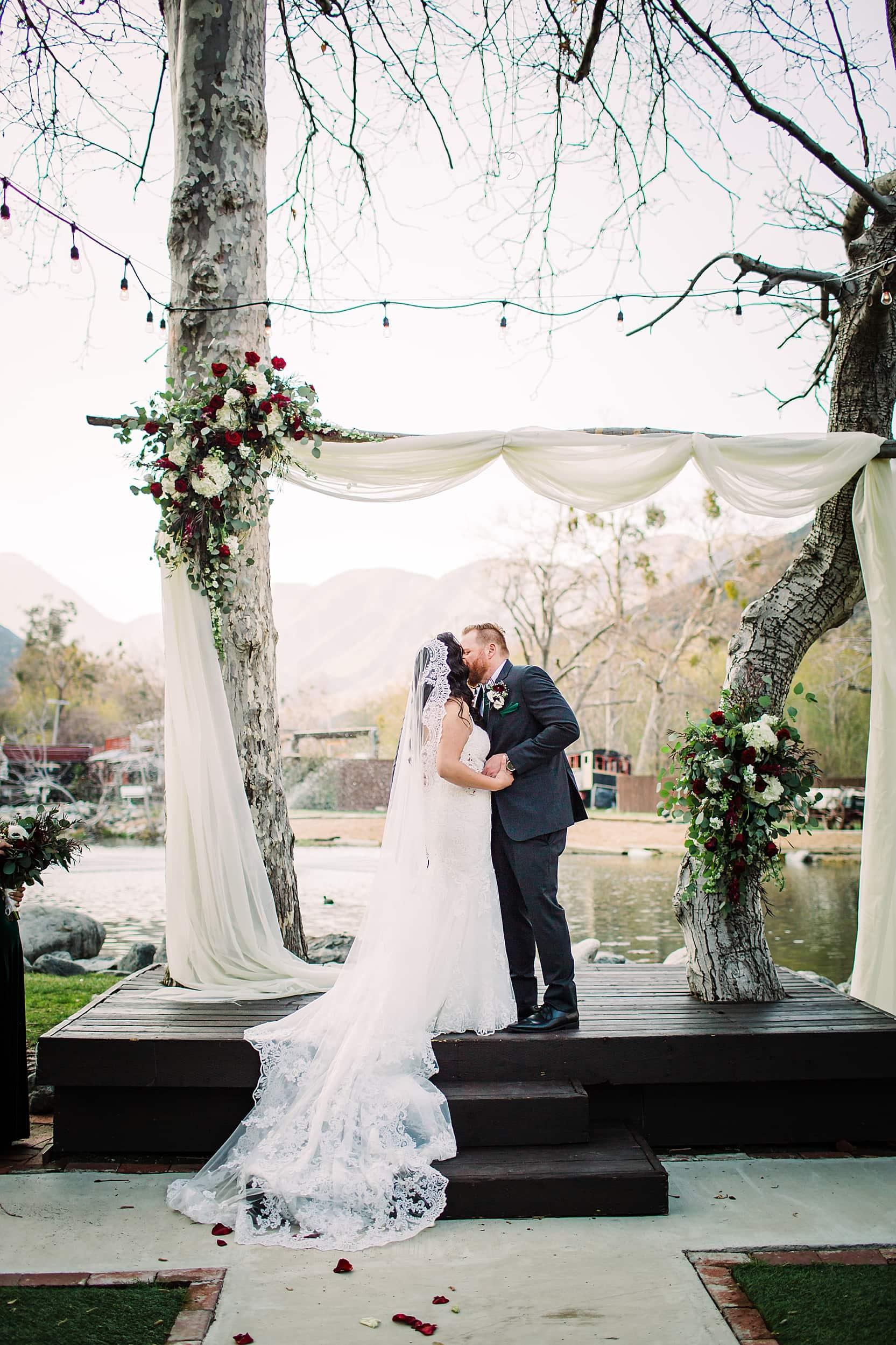First Kiss Bride and groom hidden acres Lytle Creek wedding